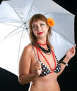 Woman in bathing suit with white umbrella beautiful adult on black background Royalty Free Stock Photos