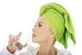 Woman in bathrobe drinks water beautiful Royalty Free Stock Photos