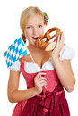 Woman with bavarian flag and pretzel young happy in a dirndl Royalty Free Stock Photography