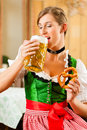Woman in Bavarian Tracht in restaurant or pub Stock Photography