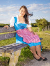 Woman in bavarian traditional dirndl a the nature Royalty Free Stock Images