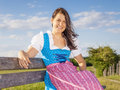 Woman in bavarian traditional dirndl a the nature Royalty Free Stock Photography