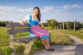 Woman in bavarian traditional dirndl a the nature Royalty Free Stock Photo