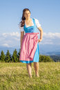 Woman in bavarian traditional dirndl a the nature Stock Photos