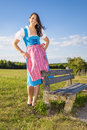 Woman in bavarian traditional dirndl a the nature Royalty Free Stock Image