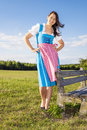 Woman in bavarian traditional dirndl a the nature Stock Photo