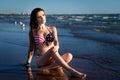 Woman on the beach in american flag bikini. Summer Royalty Free Stock Photo