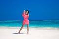 Woman on the beach. Beautiful slim girl model in red dress resti Royalty Free Stock Photo