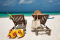 Woman at beach with chaise-lounges Royalty Free Stock Photography