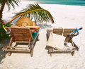 Woman at beach with chaise-lounges Royalty Free Stock Images
