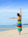 Woman at the beach enjoying her vacations in paradise Royalty Free Stock Photo