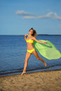 Woman at the beach holding sarong up in the air Royalty Free Stock Images