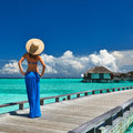 Woman on a beach jetty at Maldives Stock Image