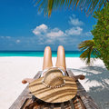 Woman at beach lying on chaise lounge beautiful Stock Photo