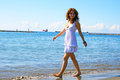 Woman on beach pretty in white dress in limassol cyprus Royalty Free Stock Photo