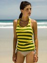 A woman on the beach in striped shirt Royalty Free Stock Photo