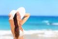 Woman on beach sunbathing enjoying sun in bikini tropical vacation holidays travel in summer beautiful young mixed race asian Royalty Free Stock Photo