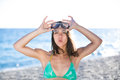 Woman on beach vacation having fun with snorkeling mask,enjoying the sun on summer day.Woman in a tropical sea with a scuba diving Royalty Free Stock Photo