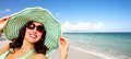 Woman on the beach vacation wearing sunglasses and a hat summer Royalty Free Stock Photo