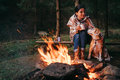 Woman and beagle dog warm near the campfire Royalty Free Stock Photo