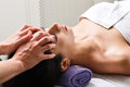 Woman beautician doctor make head massage in spa wellness center Royalty Free Stock Photo