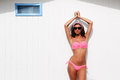 Woman with beautiful body in a beach hut portrait of Royalty Free Stock Photo
