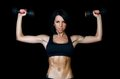 Woman with a beautiful body with dumbbells the Stock Photo