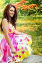 Woman with beautiful colorful dress near lake Royalty Free Stock Image