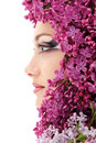 Woman beautiful face with flower lilac Stock Photos