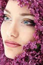 Woman beautiful face with flower lilac Royalty Free Stock Image