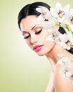 Woman with beautiful face and fresh flowers young skin care concept Royalty Free Stock Photo