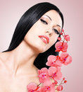 Woman with beautiful face and fresh flowers young skin care concept Royalty Free Stock Image