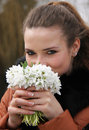 Woman beautiful girl smell and enjoy fragrance of snowdrop flowers Stock Images