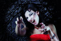 Woman beautiful halloween vampire over night background Royalty Free Stock Photo