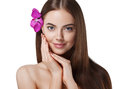 Woman beautiful portrait with flower orchid in hair isolated on white Royalty Free Stock Photo