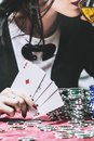 Woman beautiful young successful gambling in a casino at a table Royalty Free Stock Photo