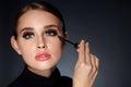 Woman With Beauty Makeup, Long Black Eyelashes Applying Mascara Royalty Free Stock Photo