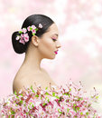 Woman Beauty Portrait in Sakura Flower, Asian Girl Bun Hairstyle Royalty Free Stock Photo