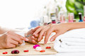 Woman at beauty salon close up of process manicure Stock Image