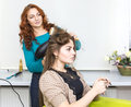 Woman in a beauty salon doing hair Royalty Free Stock Images