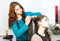 Woman in a beauty salon doing hair Royalty Free Stock Image