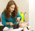 Woman in a beauty salon doing hair Stock Photography