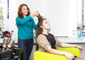 Woman in a beauty salon doing hair Stock Photos