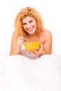 Woman in bed beautiful young having breakfast Stock Images