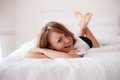 Woman in bed in the early morning portrait of a beautiful young Stock Photography
