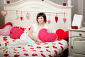 Woman in bed with hearts Stock Photo