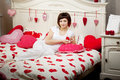 Woman in bed with hearts Royalty Free Stock Photos