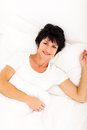 Woman bed relaxing Royalty Free Stock Images
