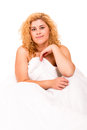 Woman in bed young happy beautiful moments after waking up Royalty Free Stock Photos