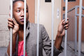 Woman behind bars Royalty Free Stock Photo